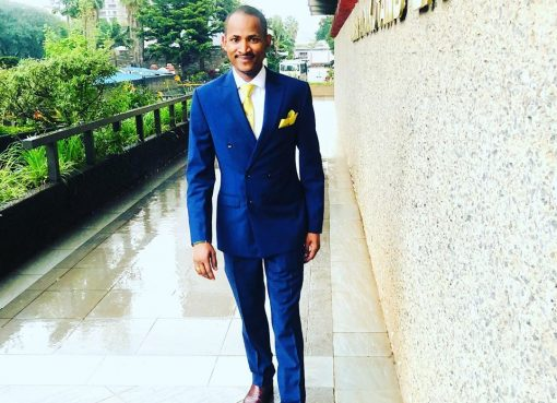 Babu Owino wearing a blue suit