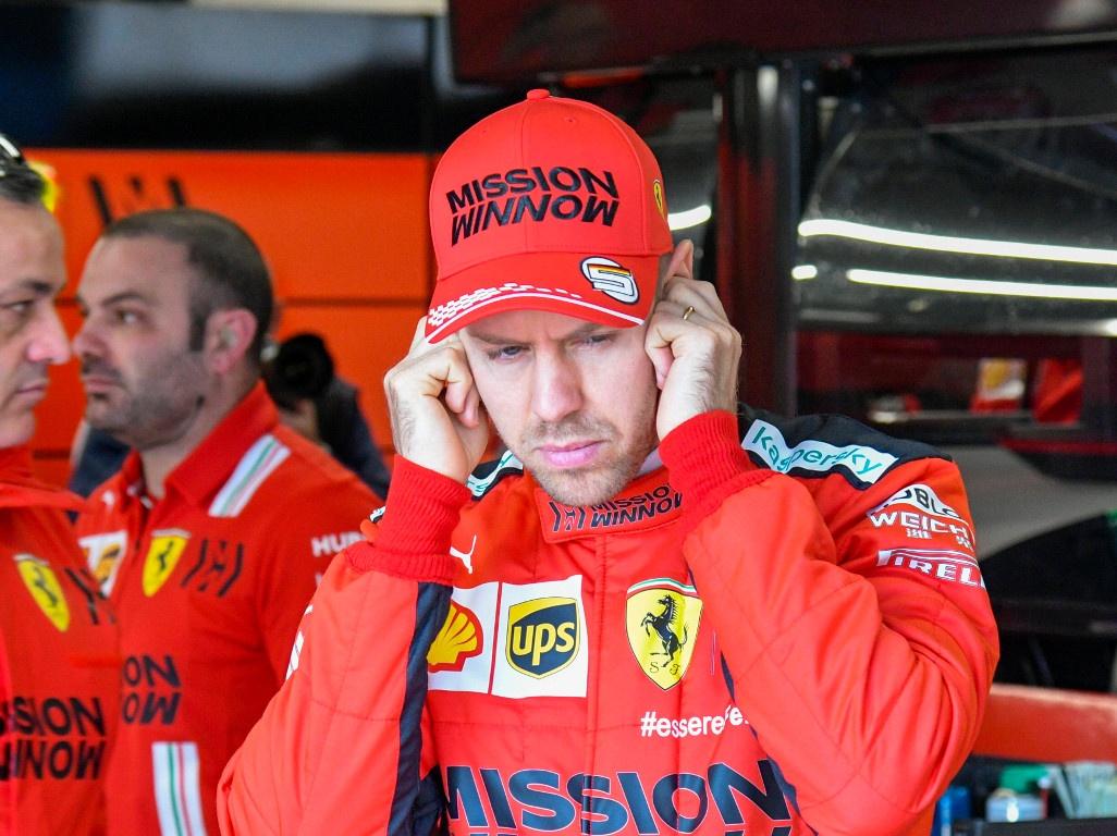 Sebastian-Vettel-fingers-in-ears