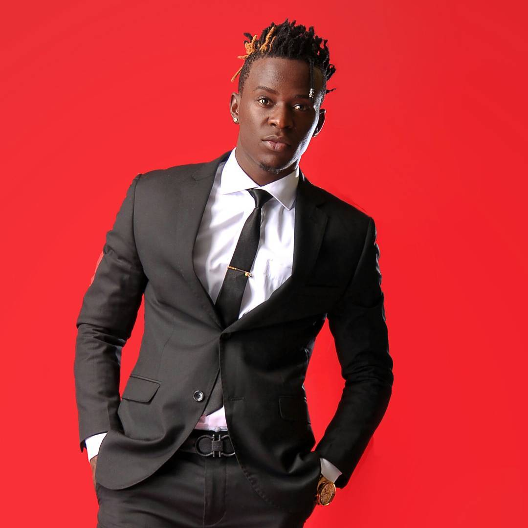 Willy Paul in a black suit