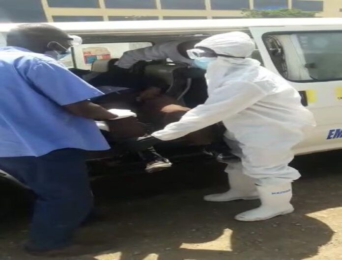 The body of the man being removed from the matatu