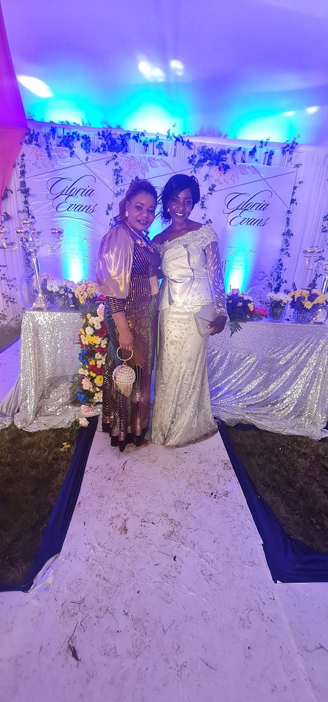 Anastacia Mukabwa poses with Gloria Muliro during her prewedding ceremony